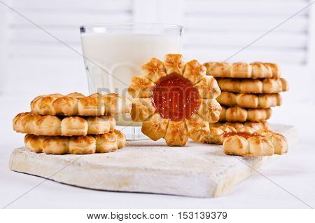 Shortbread with jam on a light background. Selective focus.