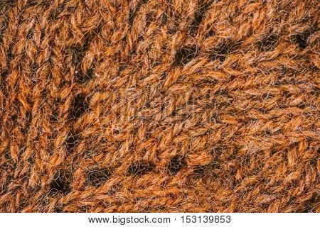 Macro flat view of knitted surface in copper eyelet