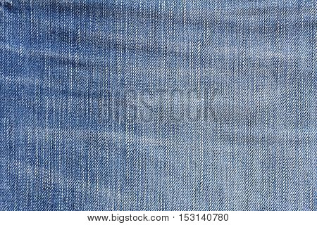 Denim jeans texture or denim jeans background. Old grunge vintage denim jeans.