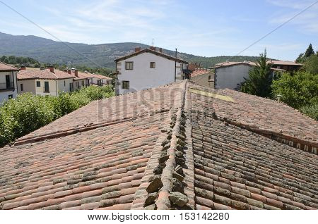 Tile roof and traditional houses in Candelario a typical mountain village in the province of Salamanca Spain.