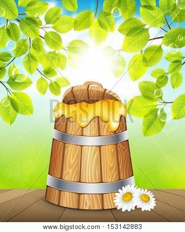 Wooden keg of honey on a background of green garden