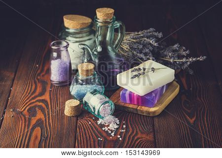 Lavender treatment soap and sea salt on wooden table