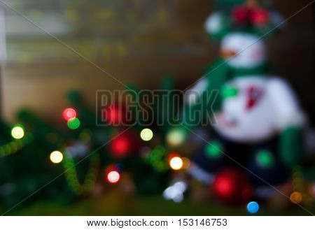 Blurred Christmas Background, Snowman And Christmas Tree On A Wooden Background