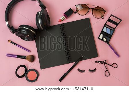 woman makeup and accessories isolated on pink background Top view