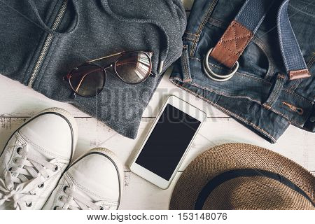 Flat lay of men casual fashion outfits on wooden background Top view