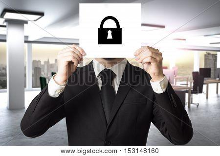 businessman in modern office hiding face sign lock symbol