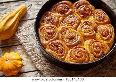 Cinnamon bun rolls homemade baked sweet autumn dessert bread food on vintage wooden table background