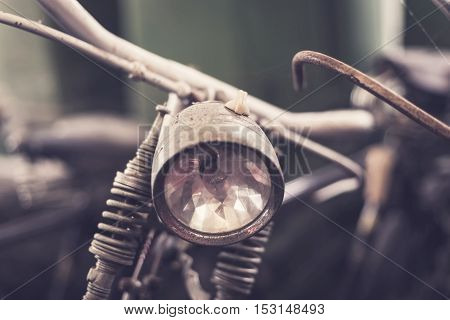 Close up headlight of old rusty vintage bicycle