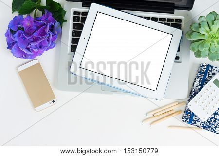Modern Laptop, phone and tablet on white table mock up flat lay scene, copy space on blank screen