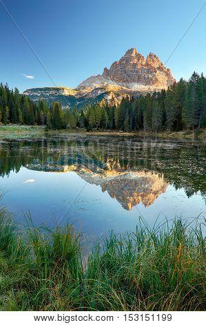 Lake mountain landcape with Alps peak reflection Lago Antorno Dolomites