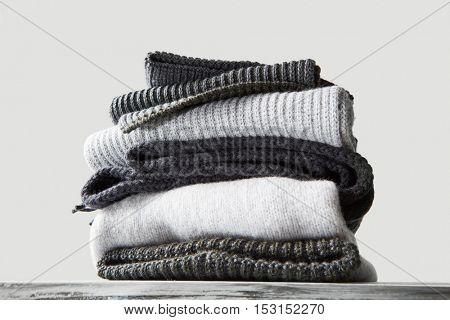 stack of warm winter knitted sweaters