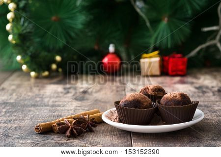 Christmas chocolate truffles on wooden table background