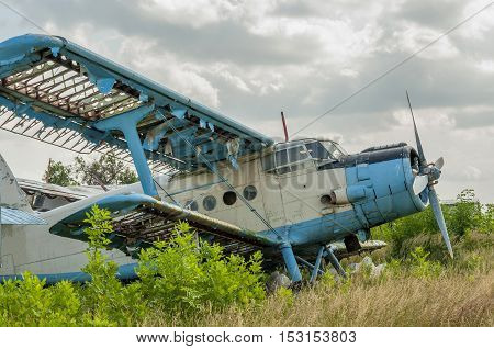 Old russian biplane aircraft abandoned