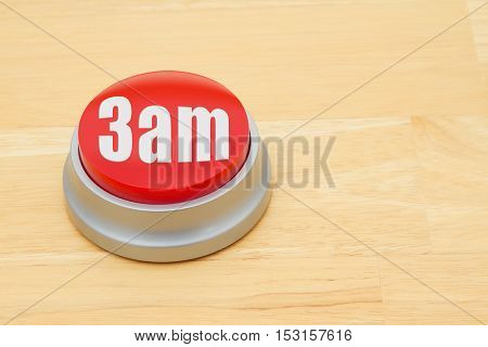 A 3 am red push button A red and silver push button on a wooden desk with text 3 am