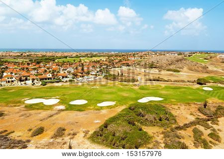 Aerial from a golf course on Aruba island in the Caribbean sea