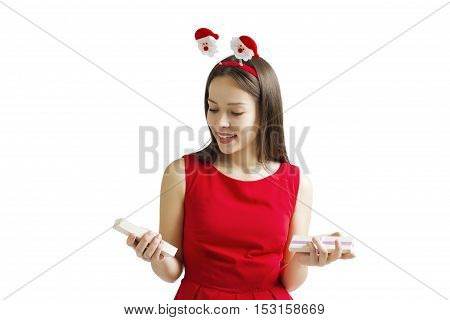 Woman's hands hold Christmas or New Year decorated gift box. on a white background.