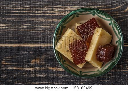Manchego cheese topped with quince jam for tapas top view.