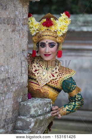 beautiful balinese dancer posing for the camera
