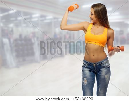 Young sporty girl in gym club