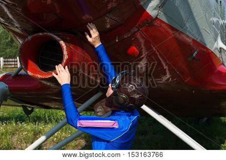 woman pilot check airplane before flying closeup