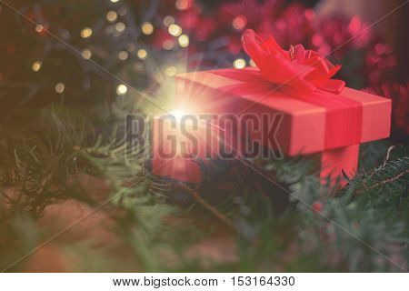 close up on magical Christmas gift under the tree