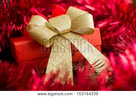 Close Up On Christmas Gift On Red Background