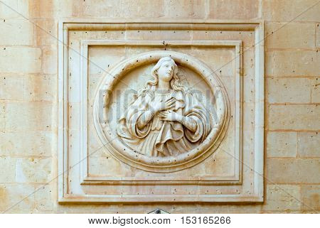 Women's bas-relief on the wall of house