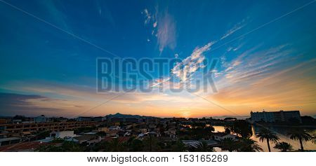 alcudia mallorca sunset over city