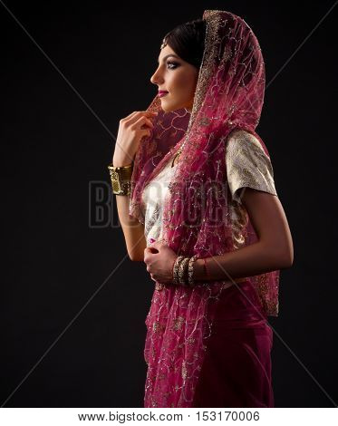 Indian young woman on black