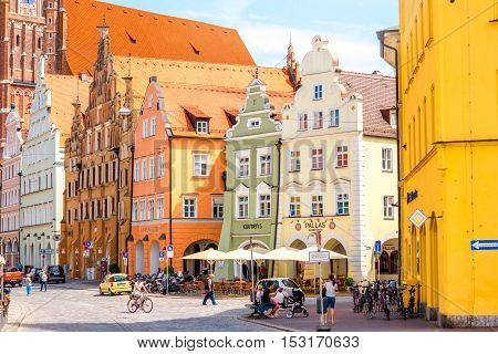 Landshut, Germany - July 04, 2016: Street view with colorful buildings in the center of Landshut old town in Germany. Landshut is a typical bavarian town