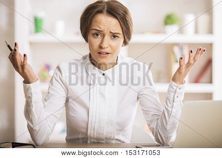 Portrait of mad young female at workplace
