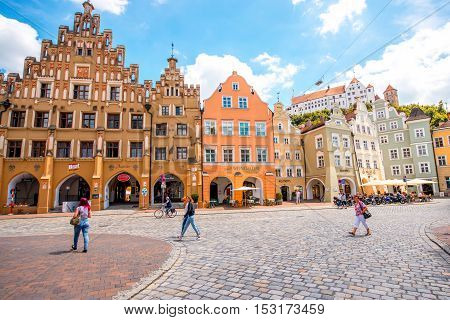 Landshut, Germany - July 04, 2016: Crowded street with colorful houses in the center of Landshut old town, Germany
