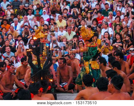 Uluwatu Bali Indonesia - December 27 2008: The spectators and performers of traditional religious dance Kecak at Uluwatu Bali Indonesia