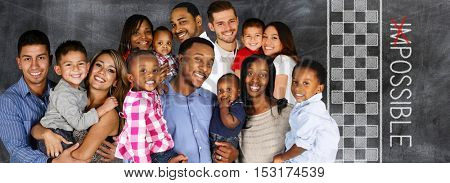 Happy young familiy standing together with a chalk board saying possible