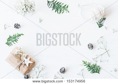Christmas composition. Christmas gift pine cones thuja branches and gypsophila flowers. Top view flat lay