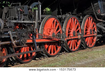 closeup view of black wheels for locomotives