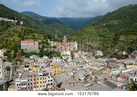 Manarola Italy - September 4 2016: Vernazza city in valley at Mediterranean sea in Liguria Italy. One of five Cinque Terre cities (unesco world heritage). Unidentified people visible.