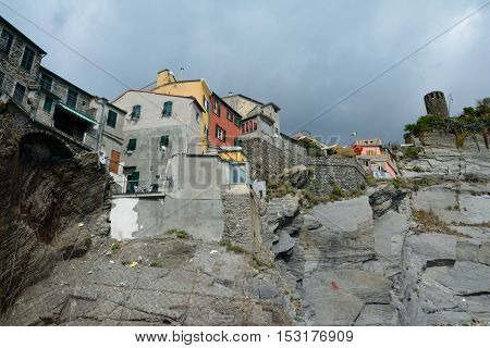 Manarola Italy - September 4 2016: Buildings on rock in Vernazza city in Liguria Italy. One of five Cinque Terre cities (unesco world heritage). Unidentified people visible.