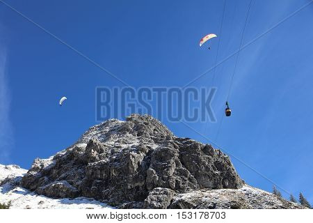 Oberstdorf, Germany - October 22, 2016: Nebelhorn cable car and Paragliders in Autumn. Its a Cable Car to Nebelhorn Mountain in Oberstdorf. Germany