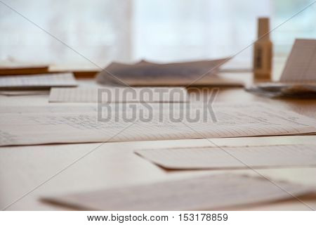 Documents and business papers are on the table on blurred background