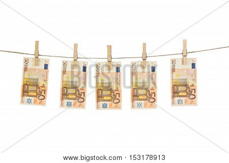 50 Euro Banknotes Hanging On Clothesline On White Background.