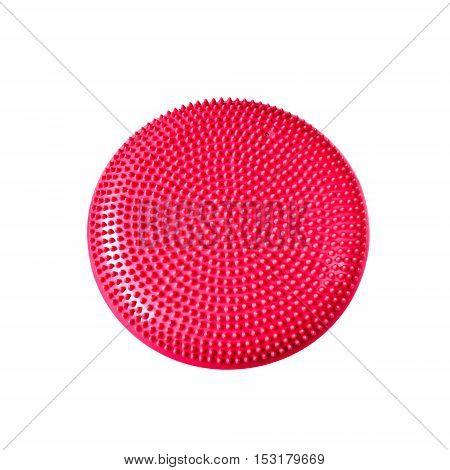 Pink balance cushion for fitness and rehabilitation isolated on white background