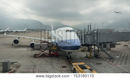Loading cargo containers into the airplane with airbridge