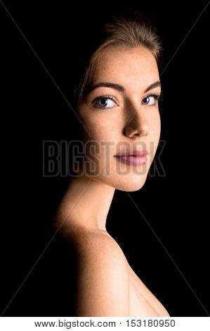 Black and white beautiful girl portrait, female isolated on black background, young lady studio shot