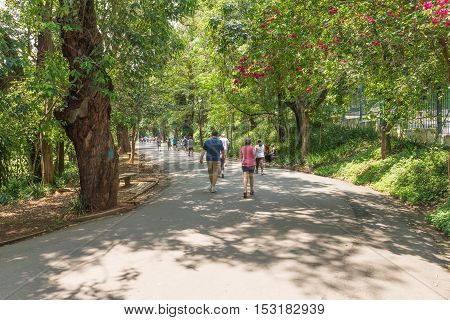 People Enjoying Their Leisure To Walk At The Aclimacao Park