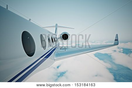 Closeup of realistic photo white, luxury generic design private jet flying over the earth's surface.Modern airplane and empty blue sky on background. Business travel concept. Horizontal. 3d rendering