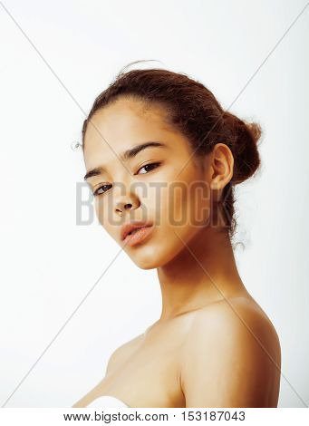 young pretty african american woman close up isolated on white background, asian mulatto tanned nude makeup, lifestyle spa people concept