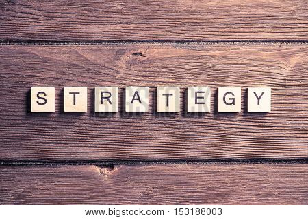 Business strategy word collected of elements of wooden elements with the letters