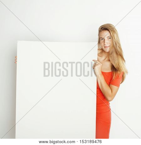 young pretty blond woman thinking showing to copyspace isolated on white close up, lifestyle people concept