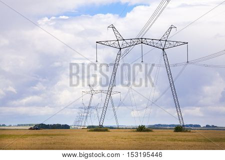 High voltage electrical power line over blue sky